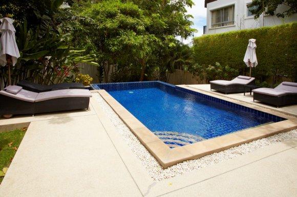 Dallage béton tour de piscine Niort